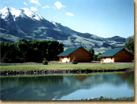 Our cabins and fishing pond with views of Emigrant Mt.